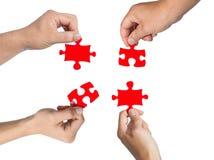 Hände und Puzzlespiel Stockfoto