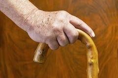 Hände und Stock Stockbild