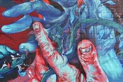 Hände verflochten, Einheit, Detroit darstellend lizenzfreie stockfotos