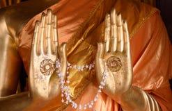 Hände von Buddha stockfotos