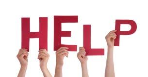 Hände, welche die Wort-Hilfe halten Lizenzfreie Stockbilder