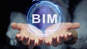 Hände zeigen rundes Hologramm BIM stock footage