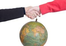 Händedruck auf der Welt Lizenzfreies Stockfoto