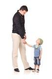 Händedruck des Mannes und des Jungen Lizenzfreie Stockfotos