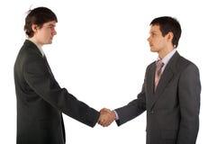 Händedruck mit zwei junger Geschäftsmännern Lizenzfreie Stockfotos