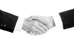 Händedruck von Geschäftsmännern in Schwarzweiss Stockbild