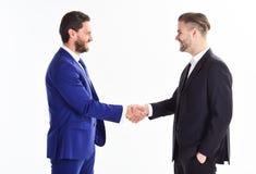 Händedruckzeichen des erfolgreichen Abkommens Lächelnder Geschäftsmann unter Verwendung des Laptop cmputer am Schreibtisch und Un stockbild
