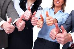 Händer av affärsfolk med tummar Fotografering för Bildbyråer
