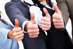 Händer av affärsfolk med tummar Royaltyfria Foton
