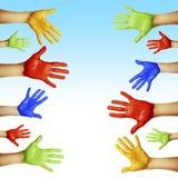 Händer av olika färger Arkivbild