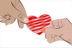 Händer för hjärta itu Arkivfoto