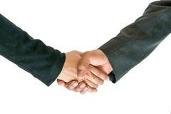 Händer för innehav för affärsman och kvinna Arkivfoto