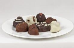 Händer gjorde closeupen för choklader för ‹ för € för â för  Fotografering för Bildbyråer