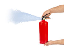 Händer med brandsläckaren royaltyfri fotografi