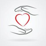 Händer med hjärtasymbol Arkivfoto