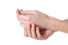 Händer med kräm Fotografering för Bildbyråer