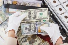 Händer med olika amerikanska dollar Royaltyfri Bild