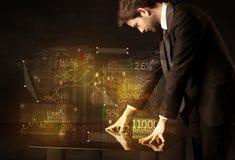 Händer navigerar på tekniskt avancerat ilar tabellen med affärssymboler Royaltyfria Bilder