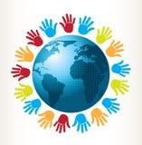 Händer och värld Arkivfoto