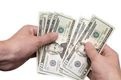 Händer räknar om U.S.-dollar Royaltyfri Bild