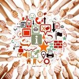 Händer runt om symboler som rymmer tummar Fotografering för Bildbyråer