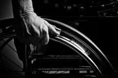 Händer som är höga i rullstol Royaltyfri Fotografi
