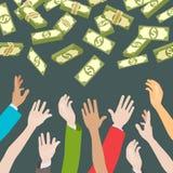 Händer som fångar pengar falla från över Arkivfoton