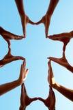 Händer som gör ett kors Royaltyfri Bild