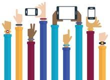 Händer som lyfts med mobila enheter Royaltyfri Bild