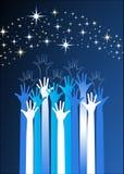 Händer som ner för stjärnorna Arkivbilder