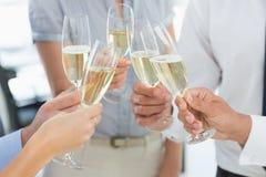 Händer som rostar med champagne Royaltyfria Foton