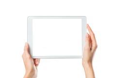 Händer som rymmer den Digital minnestavlan Fotografering för Bildbyråer