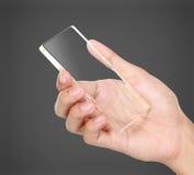 Händer som rymmer den futuristiska genomskinliga mobiltelefonen royaltyfria foton