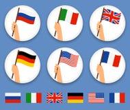 Händer som rymmer den olika uppsättningen för landsflaggor royaltyfri illustrationer
