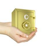 Händer som rymmer det guld- kassaskåpet Arkivbild
