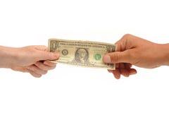 Händer som rymmer dollarbillen Arkivbild