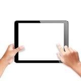 Händer som rymmer en tablet arkivfoton