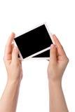 händer som rymmer fotografiet Royaltyfri Fotografi