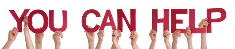Händer som rymmer rött rakt ord som du kan hjälpa fotografering för bildbyråer