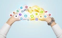 Händer som skapar en form med mobila app-symboler Fotografering för Bildbyråer