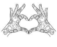 Händer som visar förälskelsezentangle arkivfoton