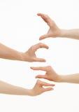 Händer som visar olika format - från litet till stort Arkivfoto