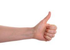 Händer som visar tummen som isoleras upp över vit Arkivfoton