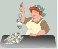 Händlerin durch Fische lizenzfreie stockbilder