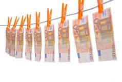 Hänga för pengar som är on-line Arkivbild