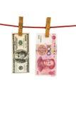 Hänga för USD och för RMB Royaltyfri Foto