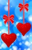 hängande hjärtor läste två arkivfoto