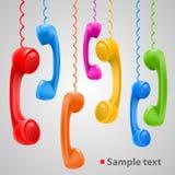 Hängande kulöra telefonlurar stock illustrationer