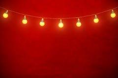Hängande kulor på rep med röd bakgrund Royaltyfria Bilder