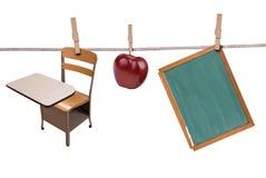 hängande skolatillförsel för klädstreck Royaltyfri Fotografi